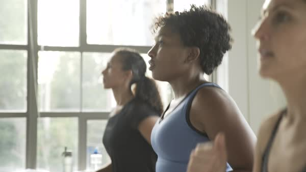 Hand held shot of three women running in place indoors Royalty-free stock video