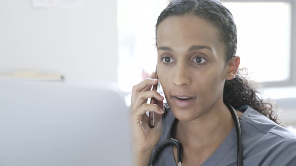 Hand held shot of a doctor on the phone Royalty-free stock video