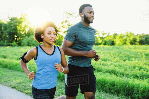 Couple running on path in park Royalty-free stock photo
