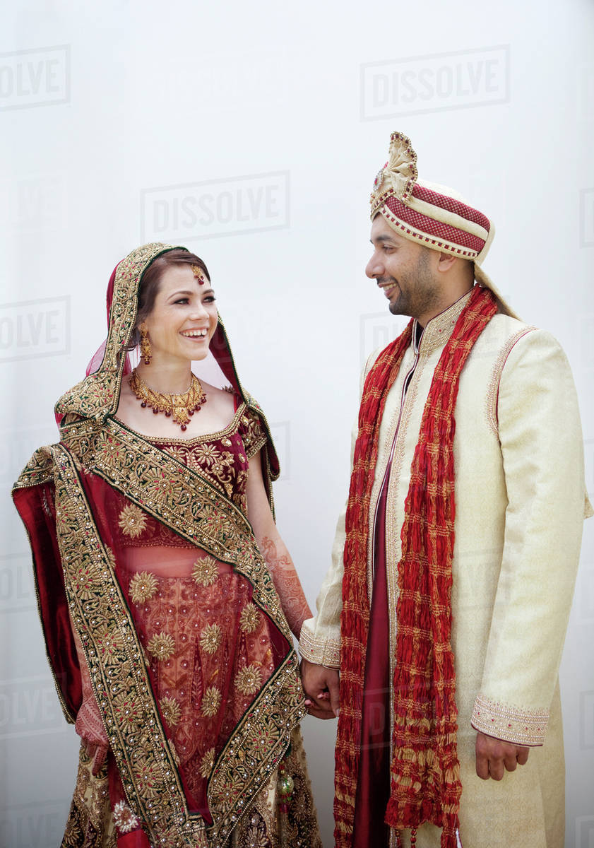 Bride and groom in traditional Indian wedding clothing   Stock