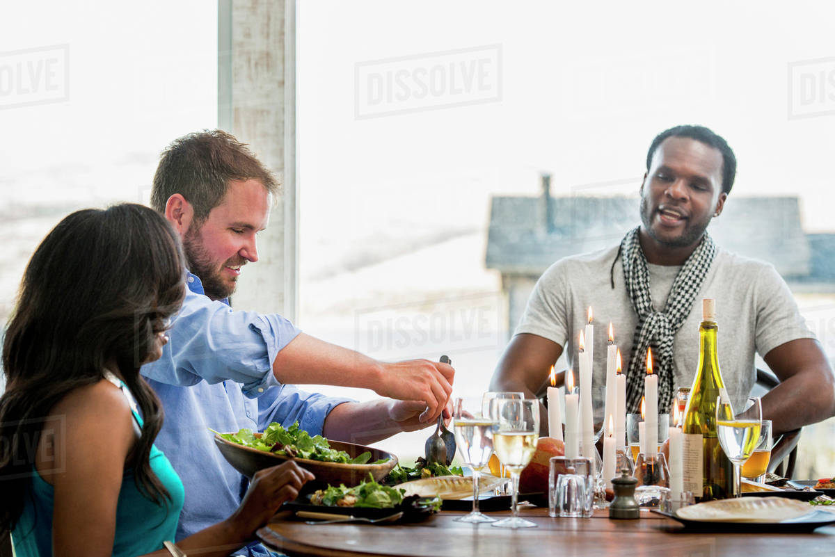 Superb Friends Eating At Dinner Party Stock Photo Download Free Architecture Designs Embacsunscenecom