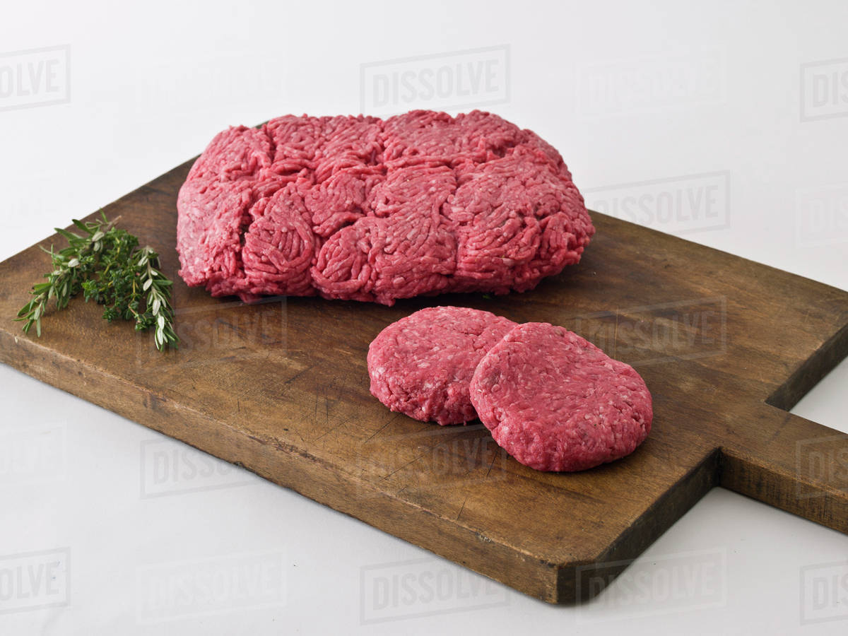 Raw Hamburger Meat On Cutting Board Stock Photo Dissolve