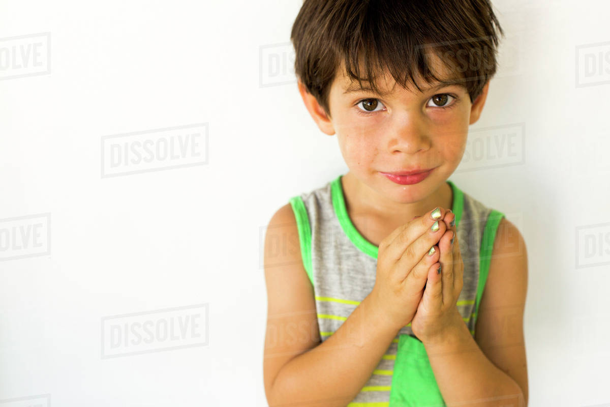 Mixed race boy wearing nail polish - Stock Photo - Dissolve