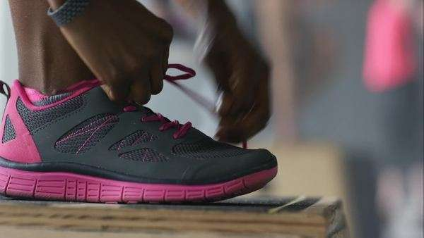 Athlete tying shoelace Royalty-free stock video