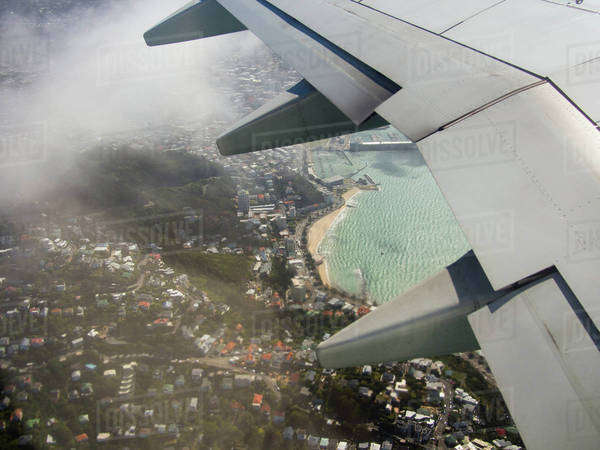 Aerial view of airplane wing flying over Wellington cityscape, Wellington, New Zealand Royalty-free stock photo
