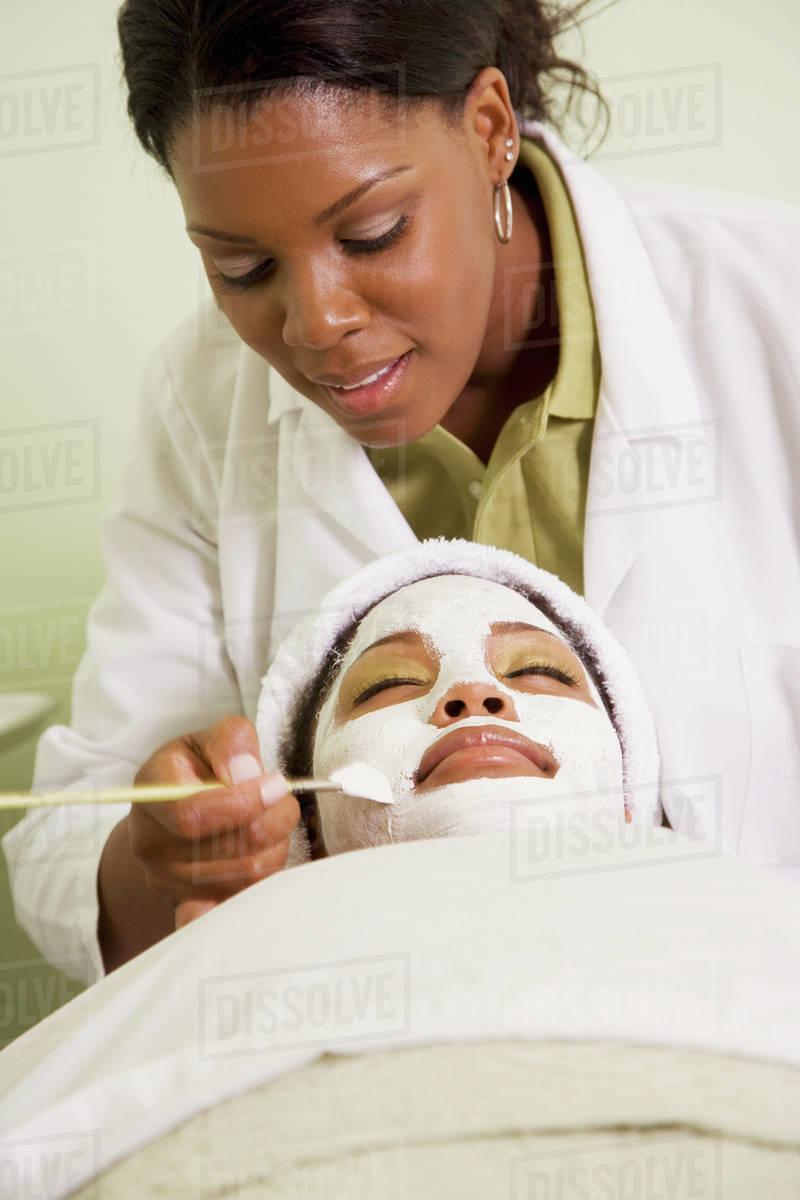 African Woman Receiving Spa Facial Treatment Stock Photo Dissolve