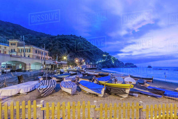 Canoes docked on beach under Monterosso al Mare cityscape, La Spezia, Italy Royalty-free stock photo
