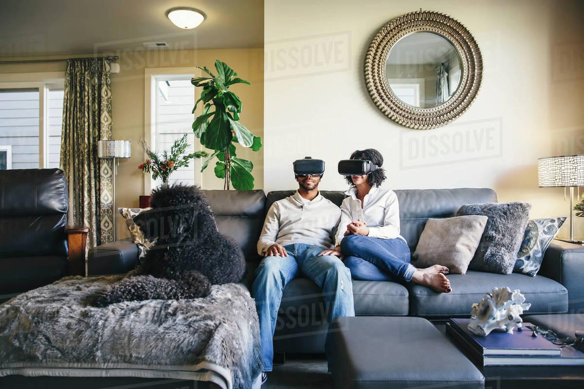 Couple using virtual reality goggles Royalty-free stock photo