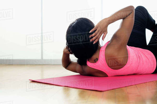Mixed race woman doing sit-ups Royalty-free stock photo