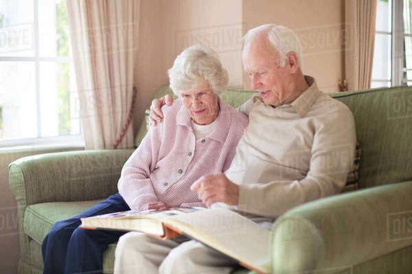 Older Caucasian couple looking at photo album Royalty-free stock photo