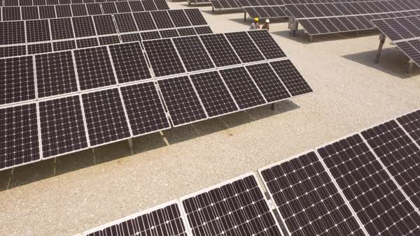 Workers walking near solar panels Royalty-free stock video