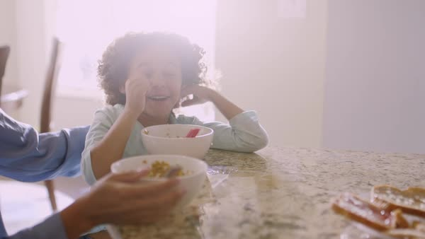 Mother and daughter eating breakfast at table Royalty-free stock video