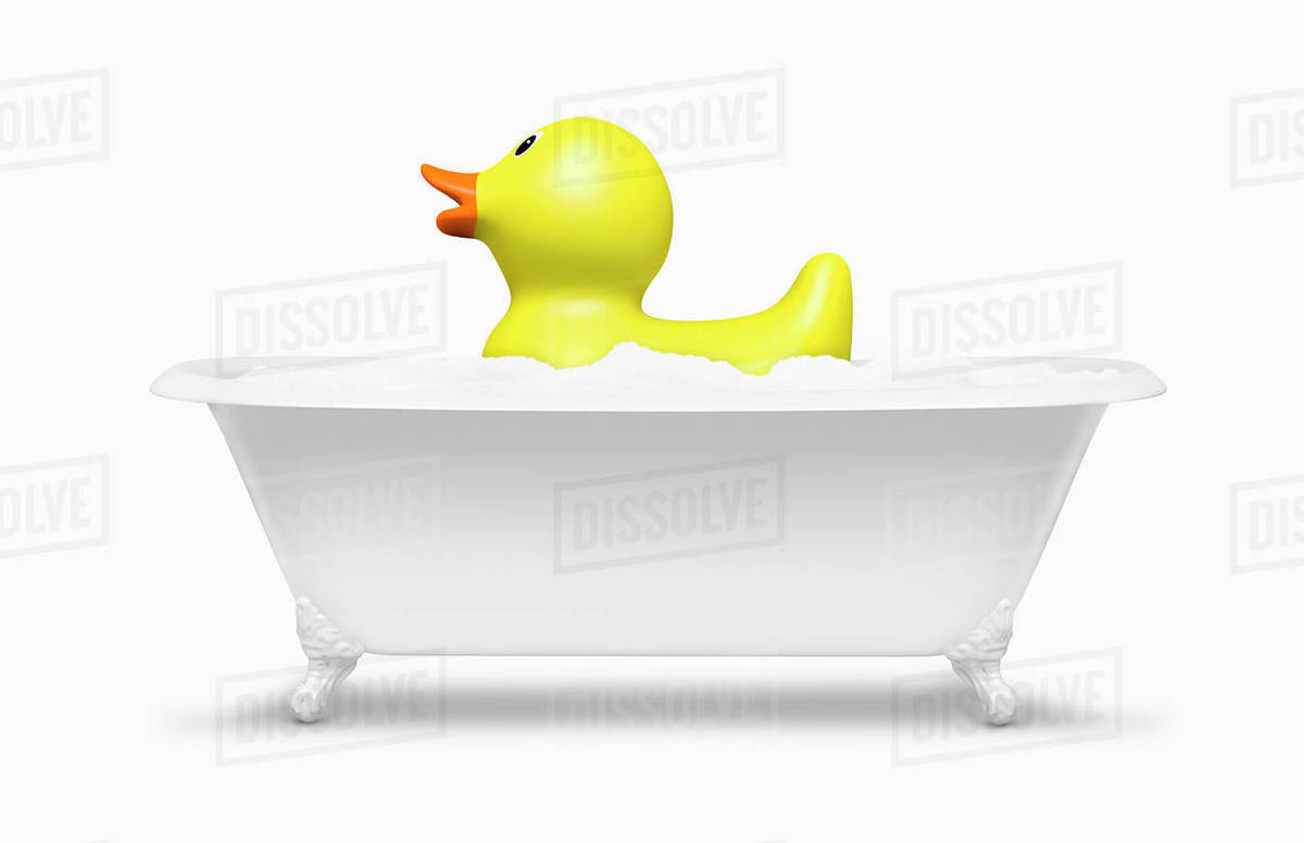 Rubber duck floating in bath - Stock Photo - Dissolve
