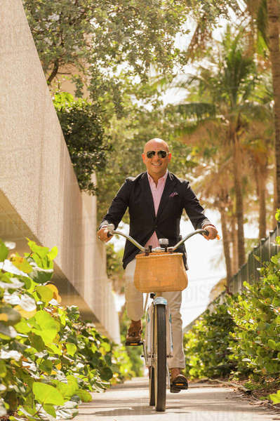 Caucasian businessman riding bicycle Royalty-free stock photo