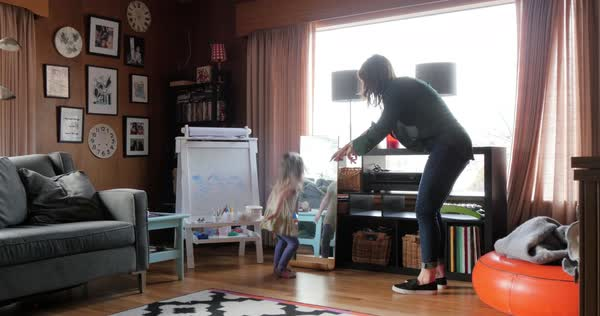 Mother playing with daughter in livingroom Royalty-free stock video