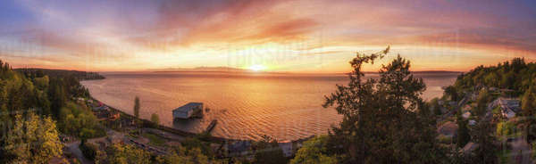 Panoramic view of sunset over lake in remote landscape Royalty-free stock photo