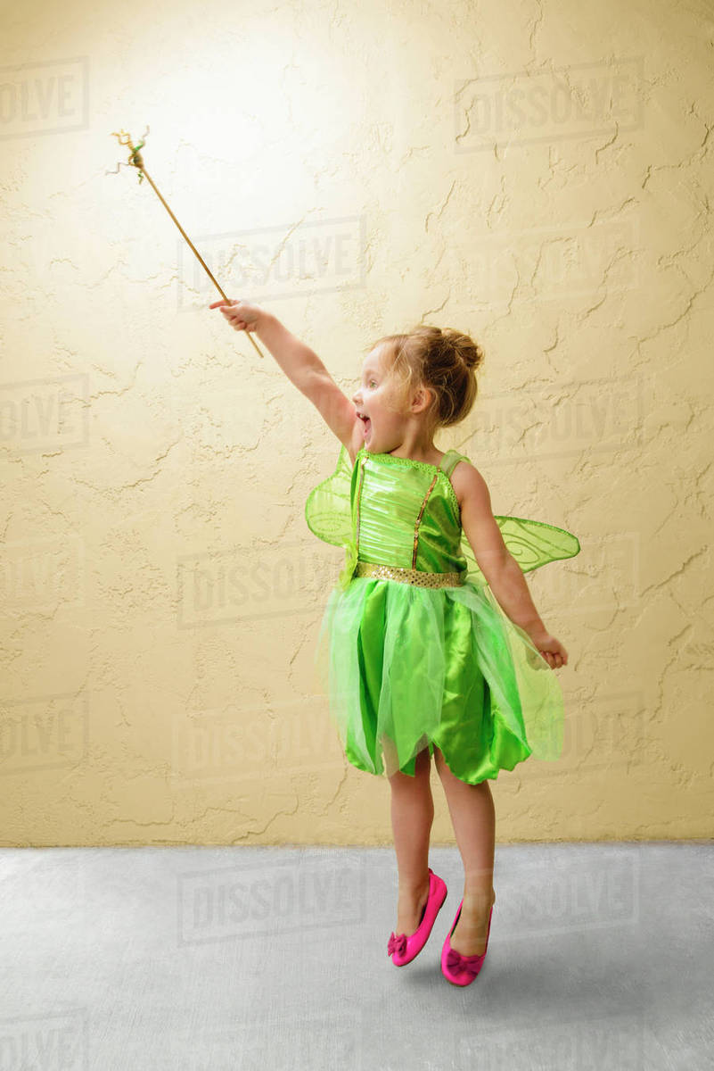 Girl wearing green fairy costume with wand Royalty-free stock photo