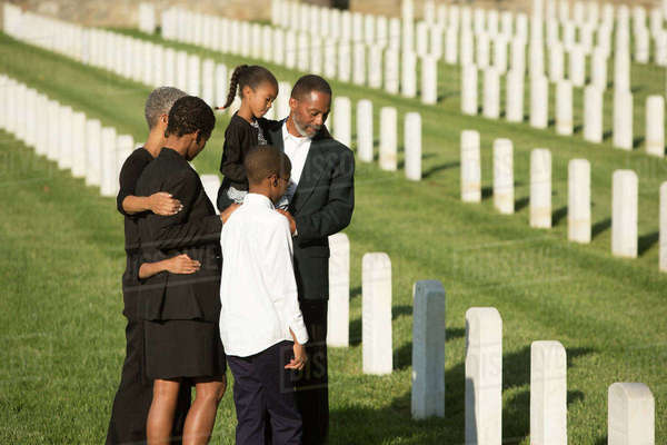Multi-generation Black family at military cemetery Royalty-free stock photo