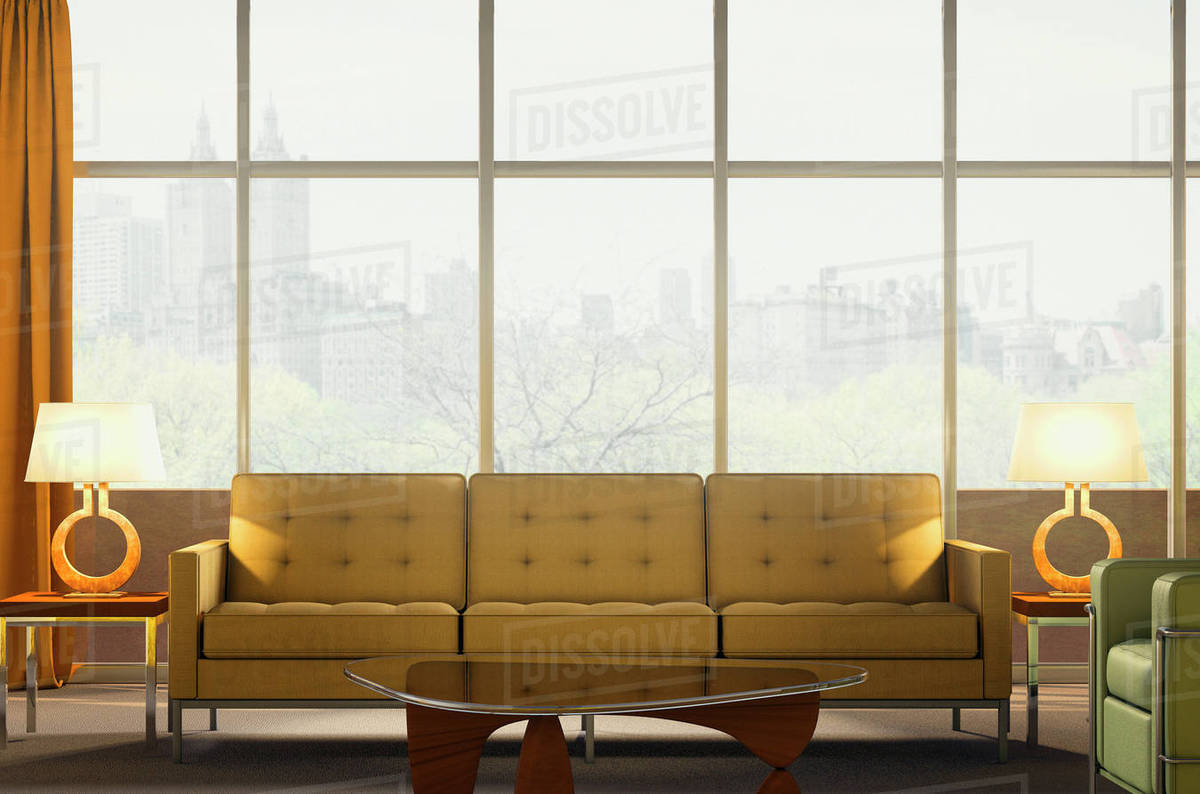 Sofa and armchair in modern penthouse apartment stock photo
