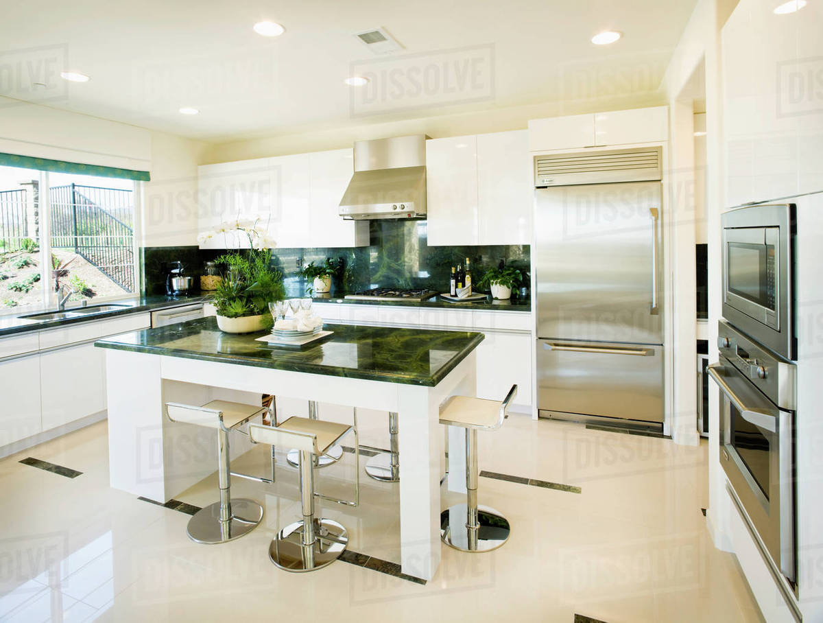 Modern white kitchen with green granite countertops D145_200_687