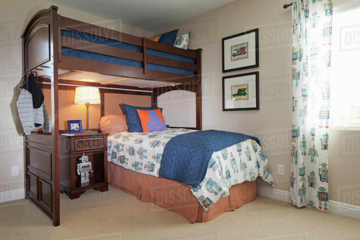 Bunk bed with study desk in kids bedroom at home - Stock Photo ...