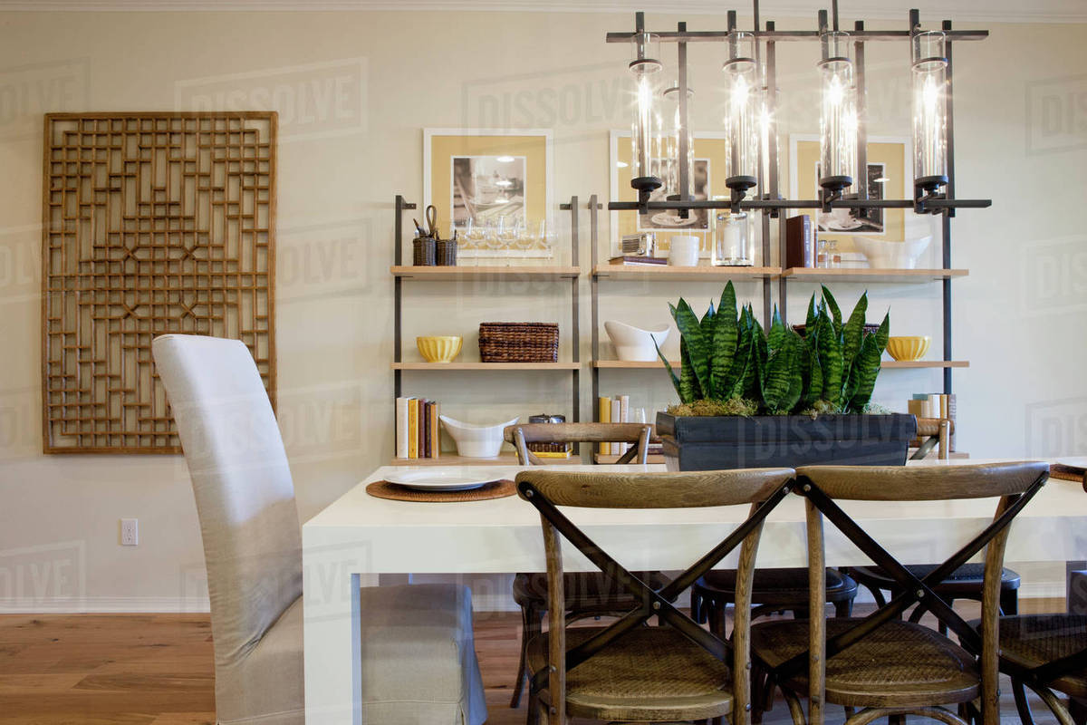 Chairs At Dining Table With Shelves In The Background Home