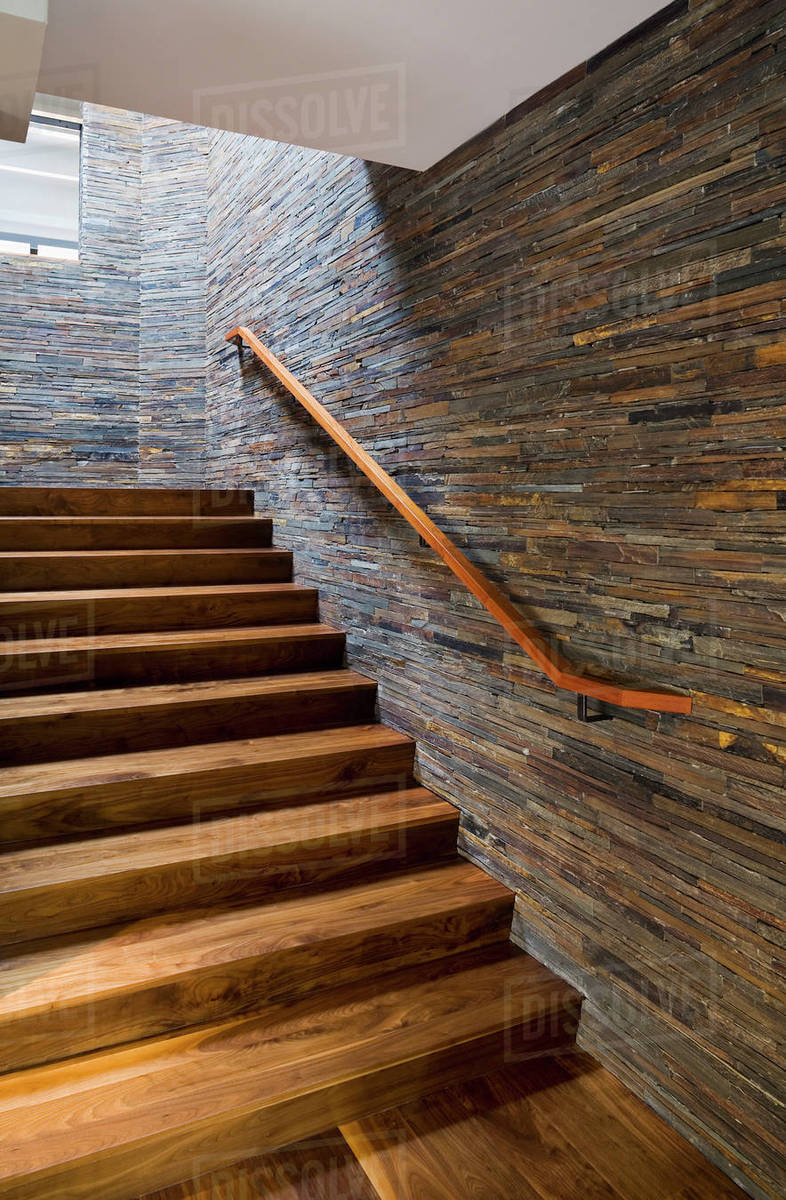 Hardwood Staircase With Stone Tile Wall