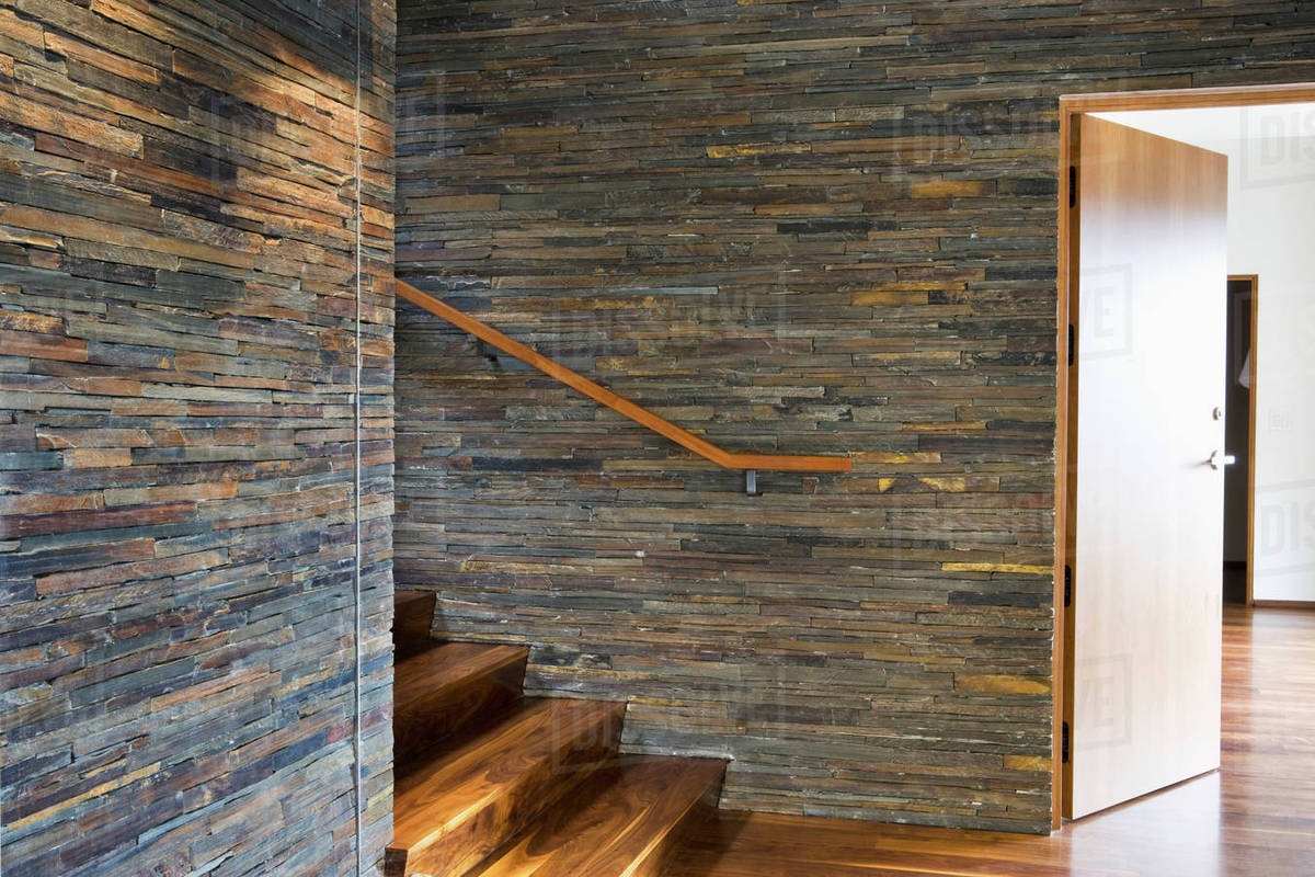 Hardwood Staircase with Stone Tile Walls - Stock Photo - Dissolve