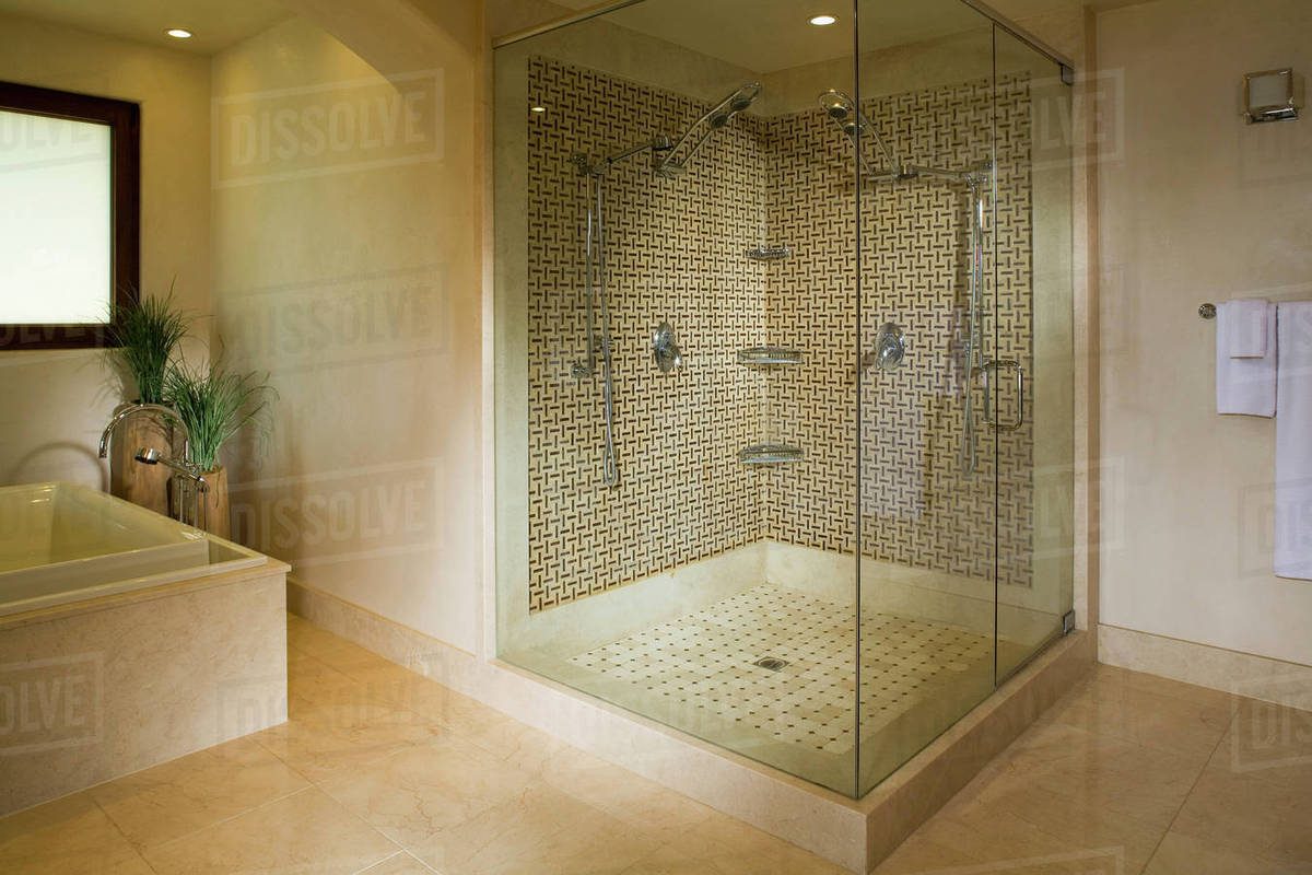 Modern seamless glass shower with double shower heads - Stock Photo ...