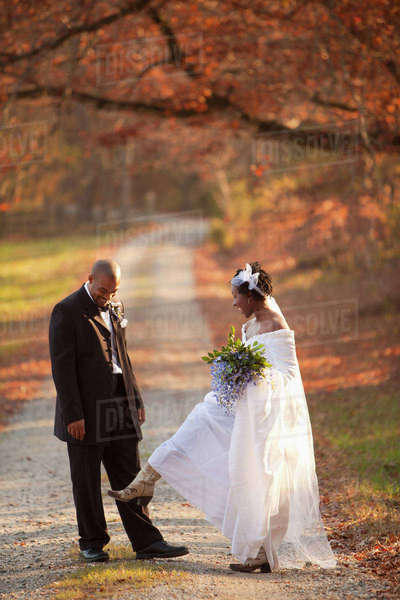 Bride and groom standing on path Royalty-free stock photo