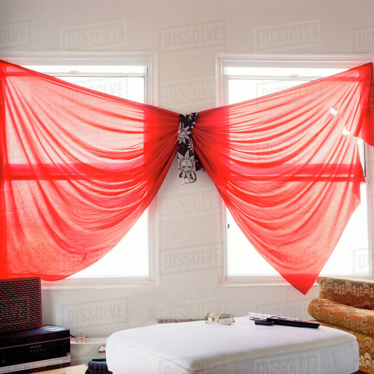 Unusual red curtains in living room stock photo