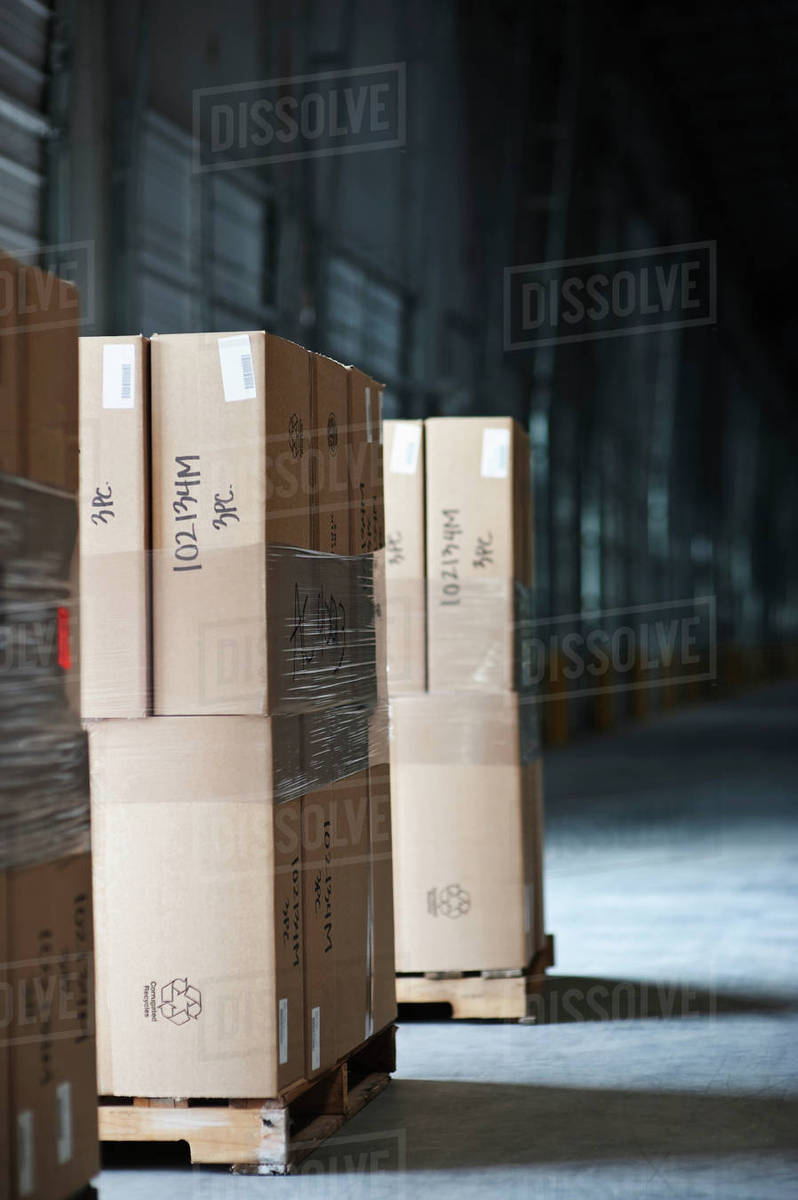 pallets of stacked boxes stock photo dissolve