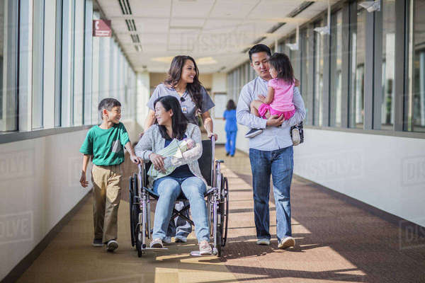 Nurse with patient and family in hospital hallway Royalty-free stock photo