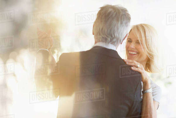Smiling older Caucasian couple dancing Royalty-free stock photo