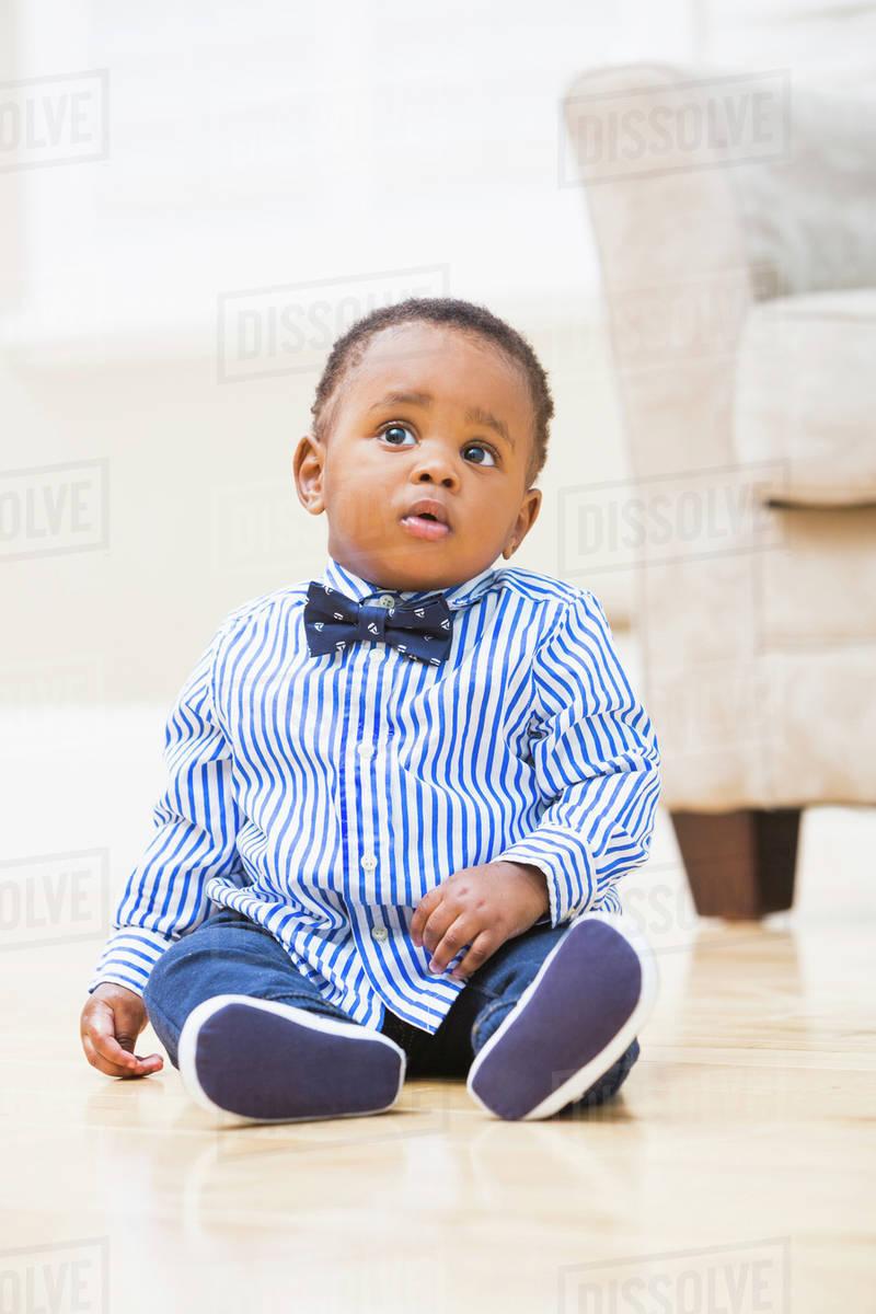 Black Baby Boy Sitting On Living Room Floor Stock Photo Dissolve