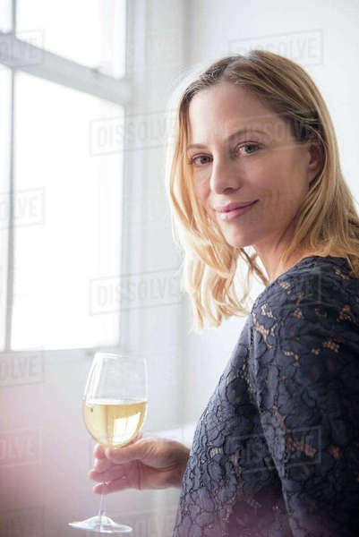 Woman drinking white wine Royalty-free stock photo