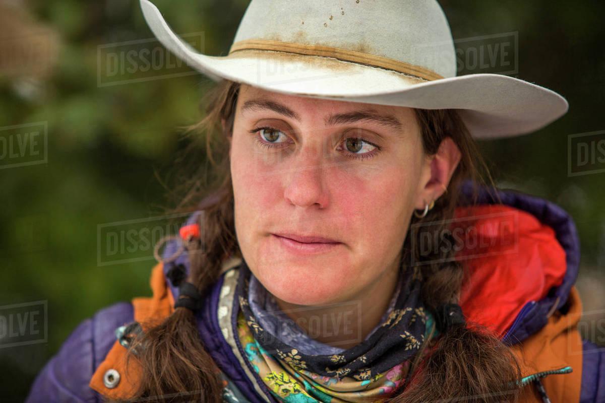 Portrait of serious Caucasian woman wearing cowboy hat - Stock Photo ... 9fea91746417
