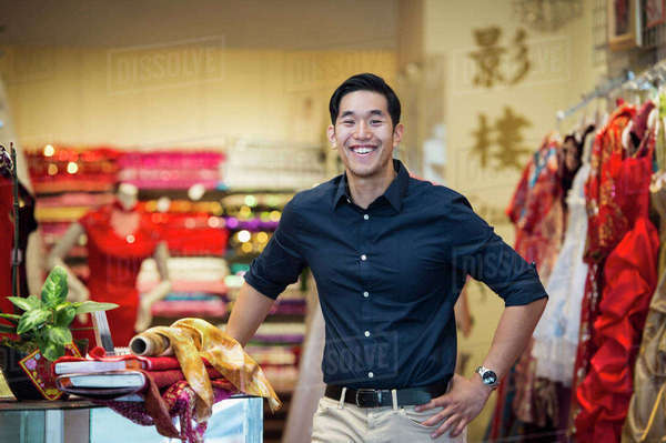 Smiling Chinese man posing in store Royalty-free stock photo