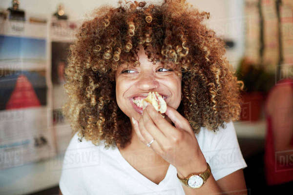 Woman biting sandwich Royalty-free stock photo