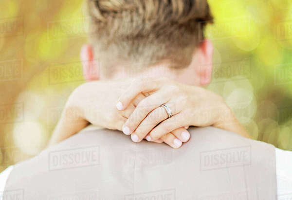 Hands of bride hugging groom outdoors Royalty-free stock photo