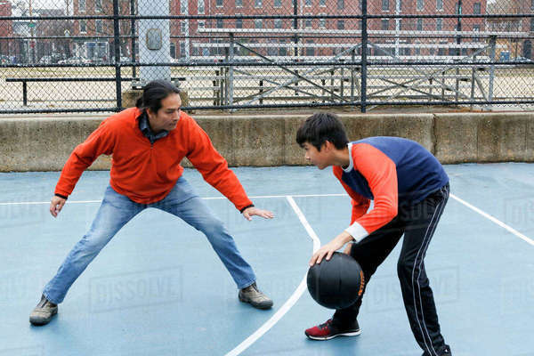 Native American father and son playing basketball Royalty-free stock photo