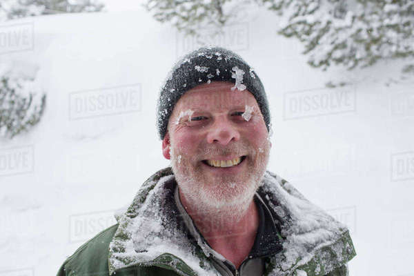 Caucasian man covered with ice and snow Royalty-free stock photo