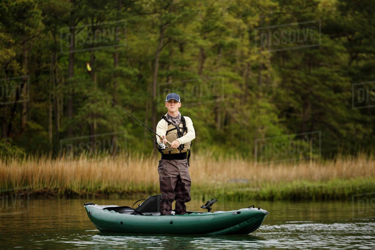caucasian man fishing on kayak stock photo dissolve