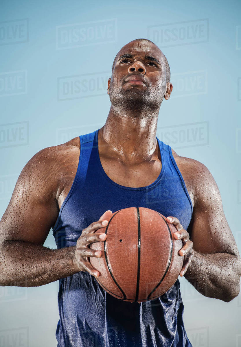 pensive sweating black man holding basketball stock photo dissolve