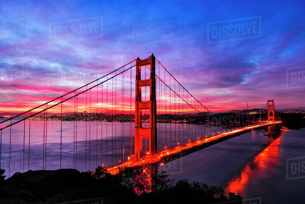 Golden Gate Bridge Lit Up At Sunset San Francisco