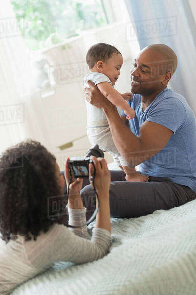Woman taking picture of father and baby Royalty-free stock photo