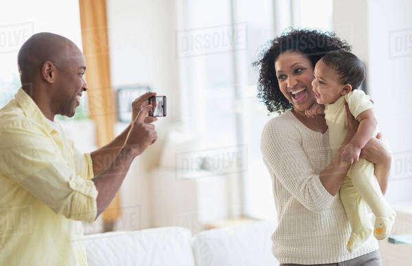 Man taking picture of mother and baby Royalty-free stock photo