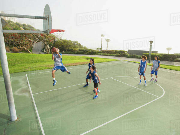 Basketball teams playing on court Royalty-free stock photo