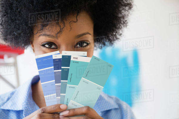 African American woman holding paint swatches Royalty-free stock photo
