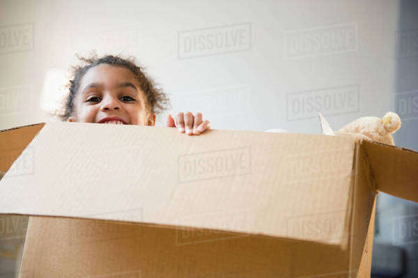 African American girl playing in cardboard box Royalty-free stock photo